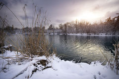 Winter landscape with sunrise sky and river. Stock Image