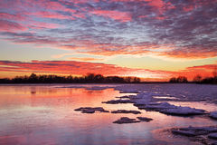 Winter landscape with sunset fiery sky. stock photography
