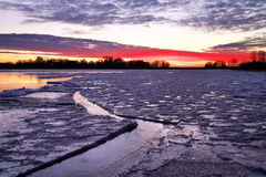 Winter landscape with sunset fiery sky. Royalty Free Stock Photo
