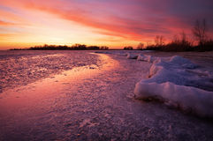 Winter landscape with sunset fiery sky. Stock Image