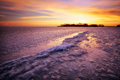 Winter landscape with sunset fiery sky. Royalty Free Stock Images