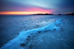 Winter landscape with sunset fiery sky. Stock Photo