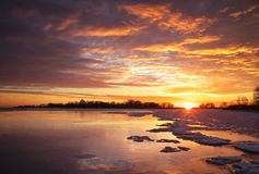 Winter landscape with sunset fiery sky. Stock Photography