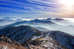 Winter landscape with sunset and foggy in Deogyusan mountains, Korea. Royalty Free Stock Photos