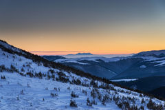 Winter landscape with sunset in mountains Stock Photography