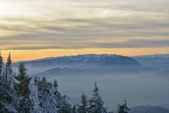 Winter landscape of sunset over the Piatra Craiului Mountains. Royalty Free Stock Images
