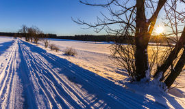 Winter landscape at sunset and road Royalty Free Stock Photo