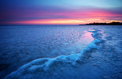 Winter landscape with sunset sky. Stock Images