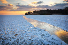 Winter landscape with sunset sky and frozen lake Stock Photography
