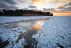 Winter landscape with sunset sky and frozen lake Royalty Free Stock Photos
