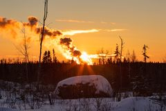Winter Landscape Sunset and Smoke in Winter Ontario Canada royalty free stock photo