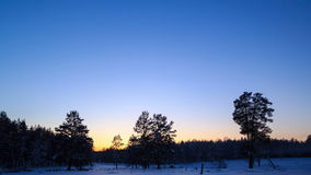 Winter landscape at sunset. Time Lapse. 4K Royalty Free Stock Images
