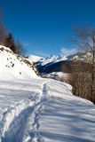 Winter landscape of Switzerland Alps. Footpath at the top of Switzerland Alps Royalty Free Stock Photo