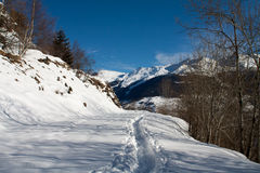 Winter landscape of Switzerland Alps. Footpath at the top of Switzerland Alps Royalty Free Stock Photos