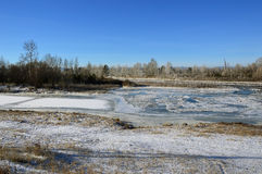 The winter landscape. Thin ice on the river. The Eastern Siberia. A clear day stock photo