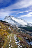 Winter landscape with trail towards snowy mountain Royalty Free Stock Photos