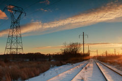 Winter landscape transmission line on of bright red sunset Stock Image