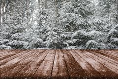 Winter landscape of trees covered with snow - Table full of snow. Flakes with space for your product advertisement royalty free stock photo
