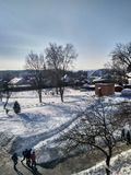 Winter Landscape in Ukraine. Morning landscape shot featuring snowy houses and beautiful sky Royalty Free Stock Photos