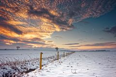 Winter landscape under the evening sunset. Royalty Free Stock Photography