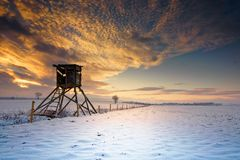 Winter landscape under the evening sunset. Royalty Free Stock Photo