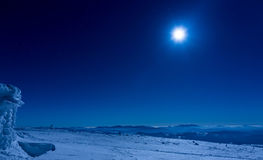 Winter landscape under the moon light stock photography