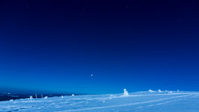 Winter landscape under the night sky stock photo