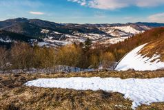 Winter landscape of Uzhansky National Park. Beautiful scenery in mountains on in fine weather warm day. spots of snow on slopes with weathered grass Stock Photography