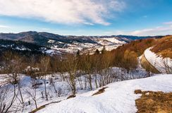 Winter landscape of Uzhansky National Park. Beautiful scenery in mountains on in fine weather warm day. spots of snow on slopes with weathered grass Stock Photos