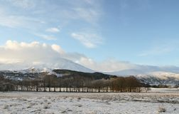 A winter landscape view of the dramatic mountains at Kinloch Rannoch,  Perthshire, Scotland, UK. Winter landscape view of the dramatic mountains at Kinloch Royalty Free Stock Image