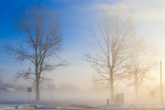 Winter landscape view fields buildings covered snow fog Royalty Free Stock Photo