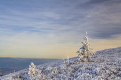 Winter landscape with a view of the hilly to mountainous Stock Photo