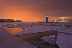 Winter landscape with a view of the lighthouse, Stock Photos