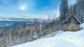 Winter landscape - view of the snowy mountain valley on moonlit evening. In the Carpathians, in Ukraine stock photos