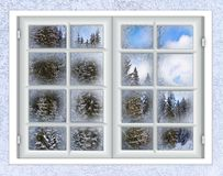 The window is covered with ice frost. Winter landscape view from the window is covered with ice frost Royalty Free Stock Images