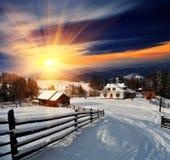 Winter landscape in the village. Winter landscape. Mountain village in the Ukrainian Carpathians Royalty Free Stock Images