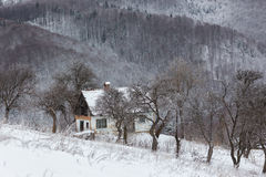 Winter landscape of the village. Winter landscape of the transylvanian village and of a house isolated on a hill, romanian rural view in Holbav - Bran, Brasov Royalty Free Stock Images
