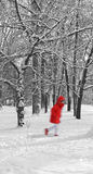 Winter landscape with walking girl in red Royalty Free Stock Photos