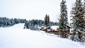 Free Winter Landscape With Snow Covered Roofs In The Alpine Village Of Sun Peaks Royalty Free Stock Photo - 84325065