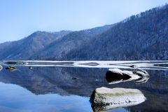Winter landscape. Wood lake under snow and ice. Winter. Royalty Free Stock Photo