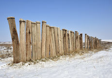 Winter landscape with a wooden fence Stock Photos