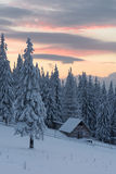 Winter landscape with wooden house in the mountains Stock Images