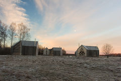Winter landscape with wooden houses. Beautiful day in Russian countryside Royalty Free Stock Photo