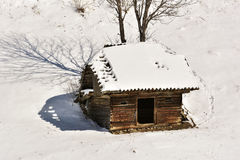 Winter landscape with a wooden hut in the mountains in Bucegi. Royalty Free Stock Image