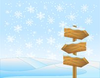 Winter landscape with a wooden  pointer Stock Photo