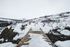 Winter landscape, wooden walk path with frozen snowdrift in winter Stock Photos