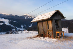 Winter landscape with wooden watchbox in mountains Stock Photos