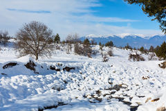 Winter lansdcape with mountain peaks view and snow valley Royalty Free Stock Photos