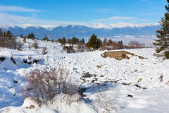 Winter lansdcape with mountain peaks view and snow valley Royalty Free Stock Image