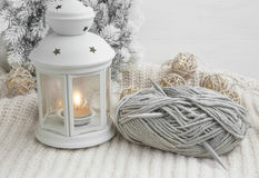 Winter lantern with knitting needles and wool Stock Images